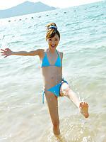 Aino Kishi Asian in blue bath suit is a true beauty enjoying sand