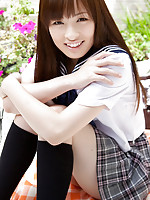 Maho Kimura Asian undresses school uniform right in the park