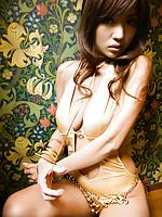 Kana Tsugihara Asian busty rubs her nooky in bikini of armchair
